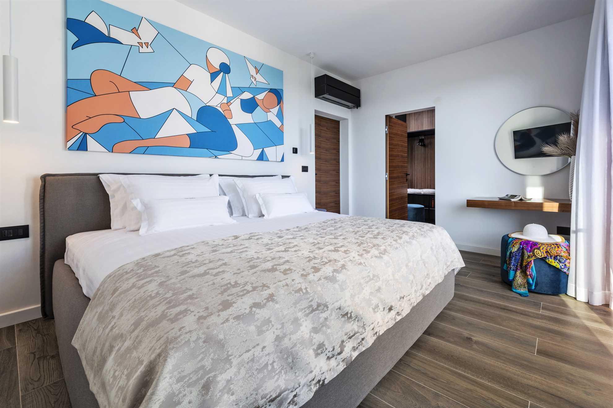 Bedroom with king-size bed in Luxury Villa Emotha - Vacation Rental on Korcula Island , Croatia