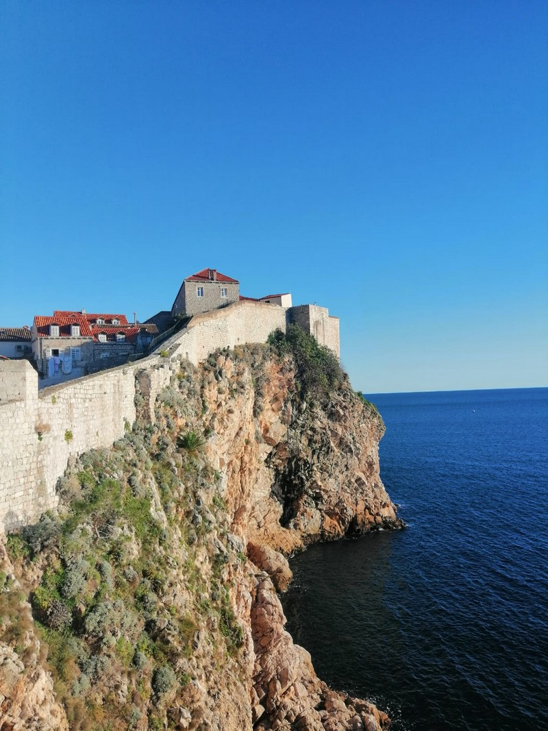 City Walls of Dubrovnik on cliffs immersed in the Adriatic Sea