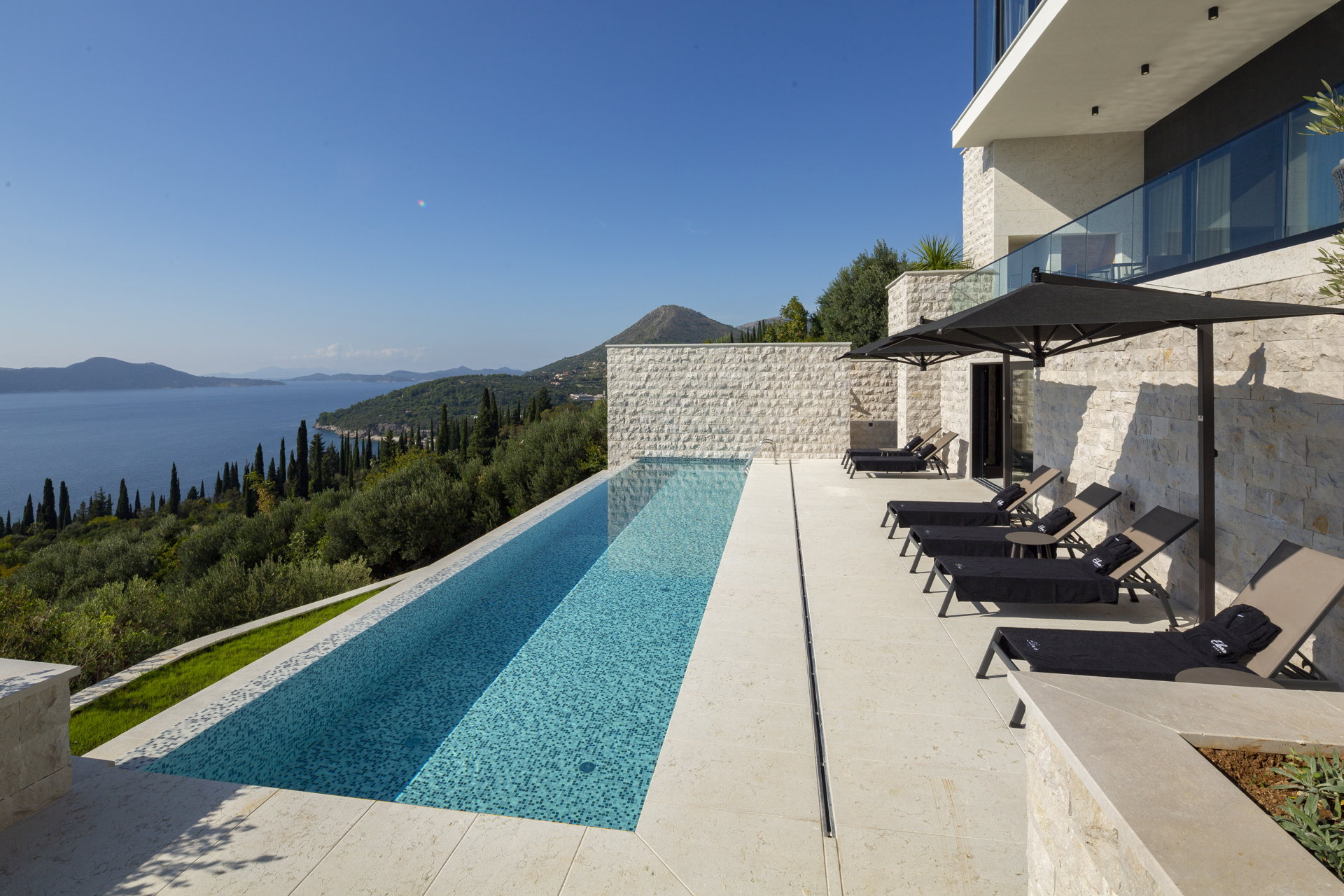 One of two infinity pools at Luxury Villa Dubrovnik Sisters with panoramic views of the sea and the islands