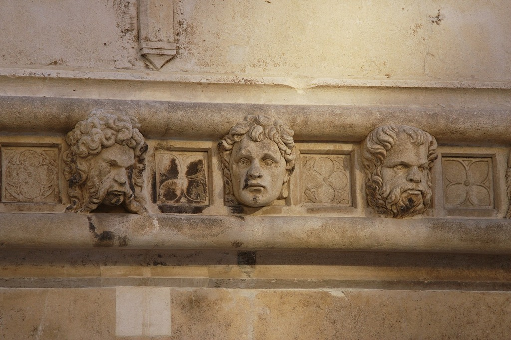 Stone sculptured heads as ornaments on Sibenik Cathedral