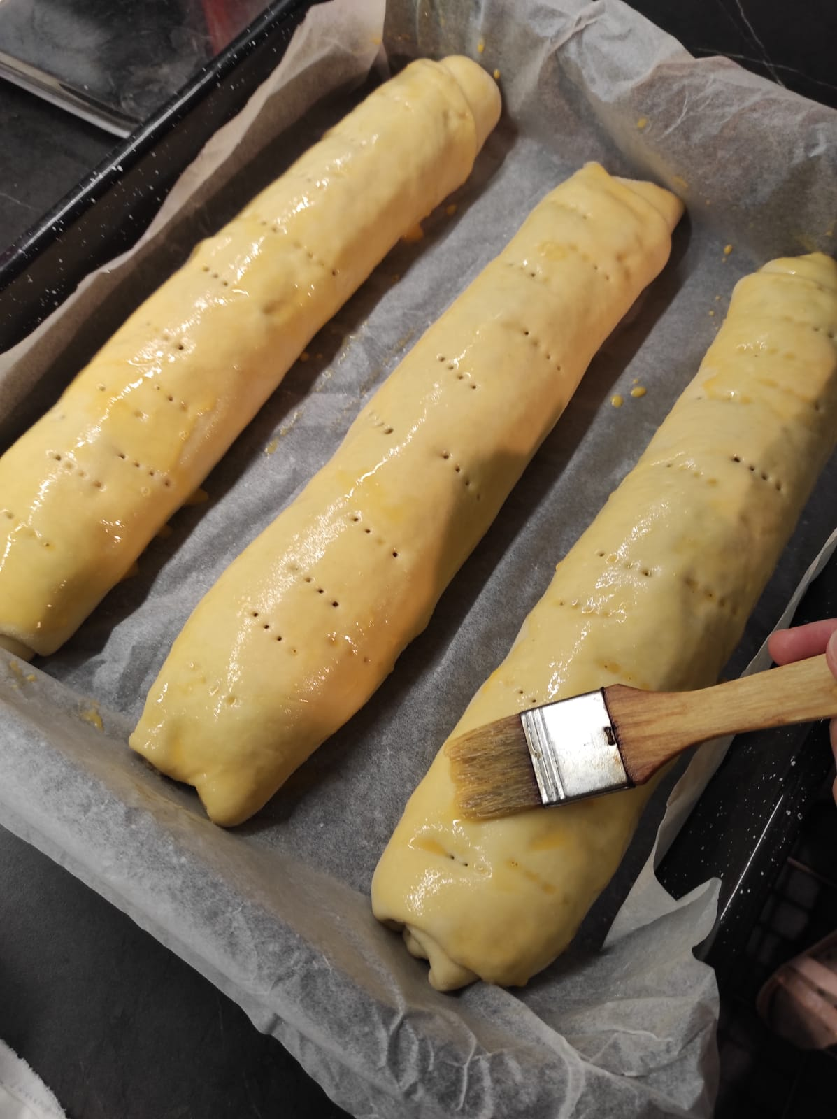Coating Orahnjaca with egg yolks