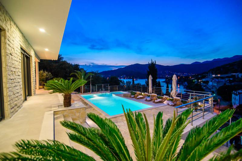 Panoramic view from the  pool terrace of Luxury Villa Neptune in Dubrovnik Riviera by night